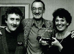 Keith Clifford (centre) with Trevor Hoyle receiving his Sony award from Sue Johnston for best actor in Randle's Scandals